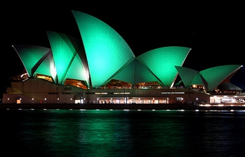 Sydney Opera House illuminated with green lights